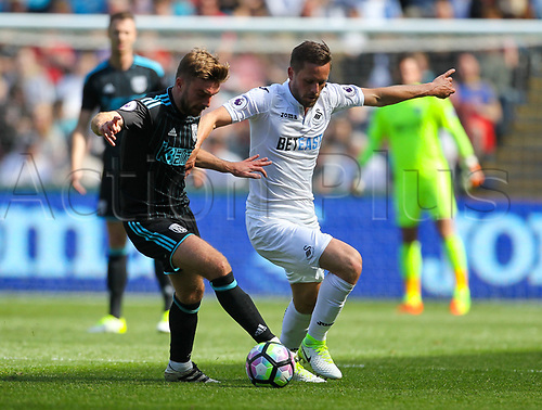 May 21st 2017, Liberty Stadium, Swansea Wales;  EPL Premier league football, Swansea versus West Bromwich Albion; James Morrison of West Bromwich Albion (L) and Gylfi Sigurdsson of Swansea City (R) battle for possession during the match