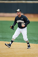 Wake Forest Demon Deacons first baseman Aaron Smith (26) on defense against the Towson Tigers at Wake Forest Baseball Park on March 1, 2015 in Winston-Salem, North Carolina.  The Demon Deacons defeated the Tigers 15-8.  (Brian Westerholt/Four Seam Images)