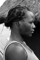 When confronted by members of the LordÕs Resistance Army (LRA), this young lady was beaten, then they proceeded to cut her ears off. Disfiguring people is a very common action of the LRA. She now resides in the Unyama Internally Displaced PeopleÕs (IDPs) camp. The war in Northern Uganda began in 1986 between the LordÕs Resistance Army (LRA) and the Ugandan PeopleÕs Defense Forces (UPDF). The LRA has reigned terror and carnage on Northern Uganda and Southern Sudan ever since. The rebels commonly abduct children to fuel their personnel needs and quickly turn them into soldiers, porters and sexual slaves. The ongoing war has significantly damaged the region and has left an ongoing burden on the local population. Unyama (off Kitgum Road North) Gulu District, Uganda, Africa. December 2005 © Stephen Blake Farrington