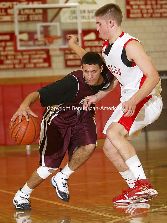 WOLCOTT, CT, 01/20/08- 012009BZ12-  Naugatuck's Tevin Pruden (11) drives against Wolcott's Ryan Pelletier (3) Tuesday night.<br />  Jamison C. Bazinet Republican-American