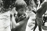 COLOMBIA  - Buenaventura -villaggio nella foresta colombiana  utilizzato per lo studio della malaria dall'OMS in quanto presenti le principali specie di zanzare anofele. Nell'immagine: dei bambini magrissimi appena usciti dall'acqua.