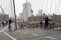 "New York, NY - 3 November 2008 - A cycle Commuter uses new ""bicycle traffic calming"" lanes on the Brooklyn Bridge pedetrian walkway"