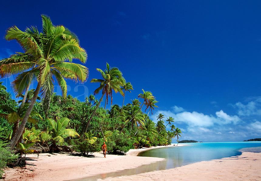 Man walking on beach One Foot Island Aitutaki Cook Islands South Pacific.