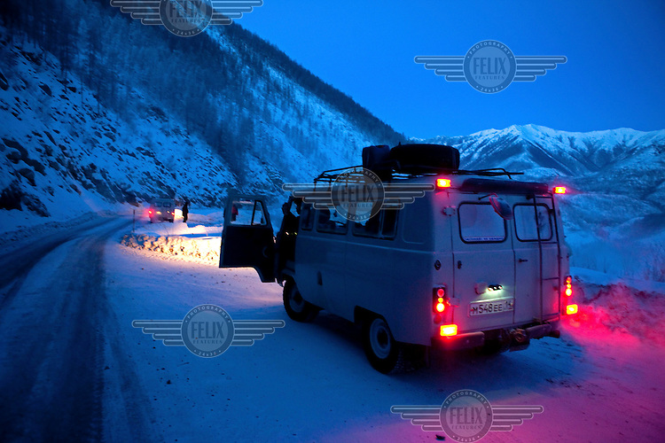 Travellers stop for a break in their UAZ minibuses on the Kolyma Highway in the Verkhoyansk mountain range, in one of the coldest inhabited areas on earth.