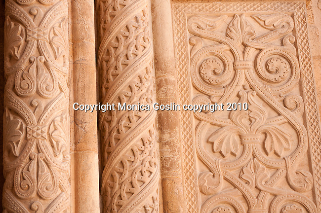 Detail of the carvings and columns just outside of the doorway of the Old Cathedral in Coimbra, Portugal.