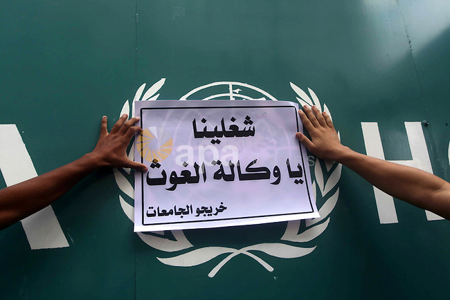 Palestinians take part in a protest against unemployment and the economic situation in the Gaza Strip, in front of the UNRWA headquarters in Gaza city on Sep. 09, 2012. Photo by Ashraf Amra