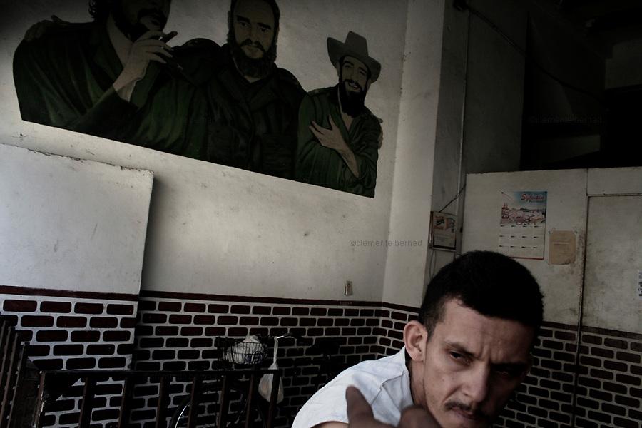 Havana (Cuba). September 2006..La Habana Vieja. Flour store with revolutionary leaders portraits..