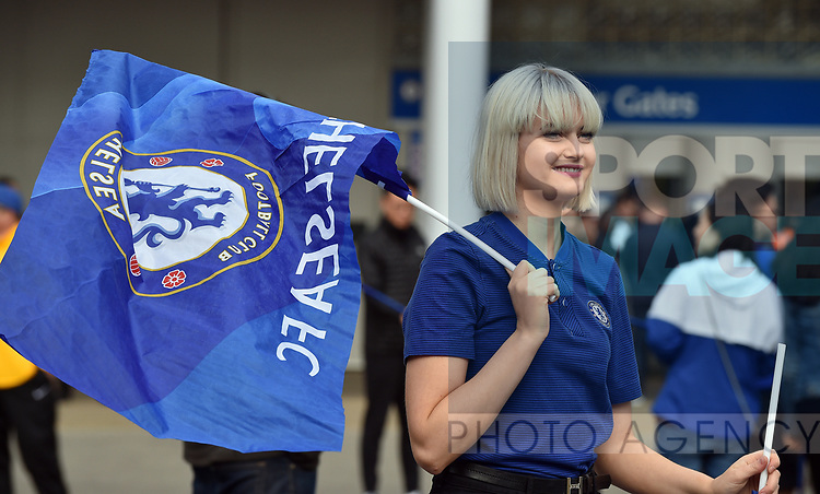 Chelsea staff hand out free flags before the start of the premier league match at the Stamford Bridge stadium, London. Picture date 30th September 2017. Picture credit should read: Robin Parker/Sportimage