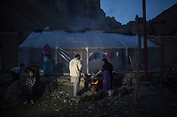 Hamina and Mohammed prepare dinner. They have no electricity for 5 weeks due to a replacement of the cables that go to their home, Yekalong, Afghanistan, 9th November 2017.<br /> <br /> Hamina et Mohammed preparent le diner. Ils n'ont plus d'électricité depuis 5 semaines dû à un remplacement des cables qui vont jusqu'à chez eux, Yekalong, Afghanistan, 9 novembre 2017.