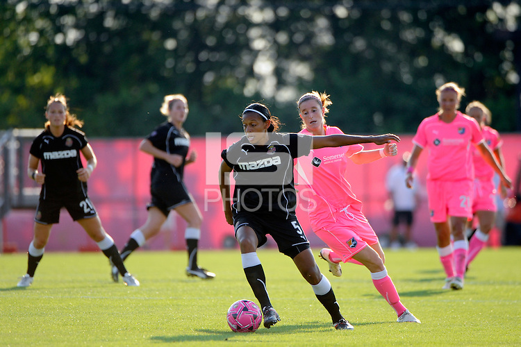 Candace Chapman (5) of the Western New York Flash is marked by Adriana (8) of Sky Blue FC. The Western New York Flash defeated Sky Blue FC 2-0 during a Women's Professional Soccer (WPS) match at Yurcak Field in Piscataway, NJ, on July 17, 2011.