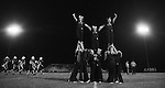 The Leslie County High School cheerleaders perform under stadium lights at half time on Friday night, Oct. 11, 2013 in Hyden, Ky. Photo by Jenna Watson