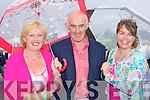 Mark Kennedy, Steve Kennedy Beaufort and Deirdre Kenny Killarney sheilding themselves from the rain at  the Killarney Races on Monday