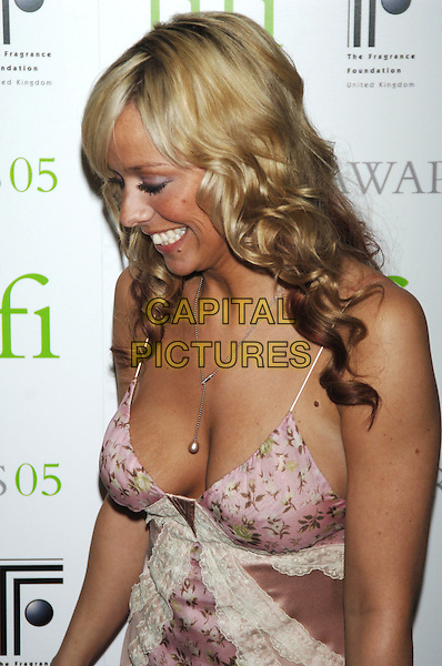 LIZ McCLARNON.UK FIFI Awards of the fragrance foundation.The Dorchester Hotel.London, 25 April 2005.portrait headshot boobs cleavage low cut pink dress flower floral pattern print profile side stretch marks.Ref: PL.www.capitalpictures.com.sales@capitalpictures.com.©Capital Pictures