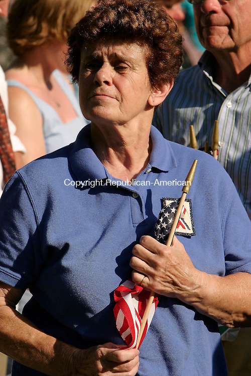 WASHINGTON, CT - 10 JULY 2005 -071005JS03--An unidentified mourner clutches an American flag as taps is played during a service of prayer and thanksgiving for Maj. Stephen Reich Sunday at Washington Town Hall. Reich and 15 other service members were killed on June 28 when their MH47 Chinook helecopter was shot down in Afghanistan --Jim Shannon Photo-- Maj. Stephen Reich, Afghanistan  are CQ