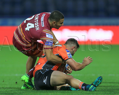 1st September 2017, John Smiths Stadium, Huddersfield, England; Betfred Super League, Super 8s; Huddersfield Giants versus Castleford Tigers; Jy Hitchcox of Castleford Tigers  is tacklesd by Darnell McIntosh of Huddersfield Giants