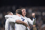 James Rodriguez of Real Madrid (raising fist) celebrates with teammates Daniel Carvajal Ramos (left) and Cristiano Ronaldo during the match Real Madrid vs Napoli, part of the 2016-17 UEFA Champions League Round of 16 at the Santiago Bernabeu Stadium on 15 February 2017 in Madrid, Spain. Photo by Diego Gonzalez Souto / Power Sport Images
