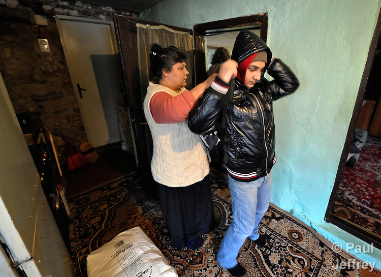 Bajram Kruezi's mother, Sabahata, helps him put on his backpack as he prepares to leave home in the morning in the Zemun Polje neighborhood of Belgrade, Serbia, on his way to the Branko Pesic School, an educational center for Roma children and families which is supported by Church World Service. Kruezi's family came to Belgrade as refugees from Kosovo, and like many Roma can't afford regular school fees. Many Roma also lack legal status in Serbia, and thus have difficulty obtaining formal employment and accessing government services. Kruezi wants to be a Muslim religious scholar when he grows up.