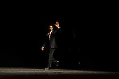 Washington, DC - March 27, 2009 -- United States President Barack Obama walks onto the stage inside the Lisner Auditorium for the ceremonial installation of U.S. Attorney General Eric Holder at George Washington University March 27, 2009 in Washington, DC. Holder has been serving as the 82nd attorney general since he was confirmed by the Senate in February of this year. .Credit: Chip Somodevilla - Pool via CNP