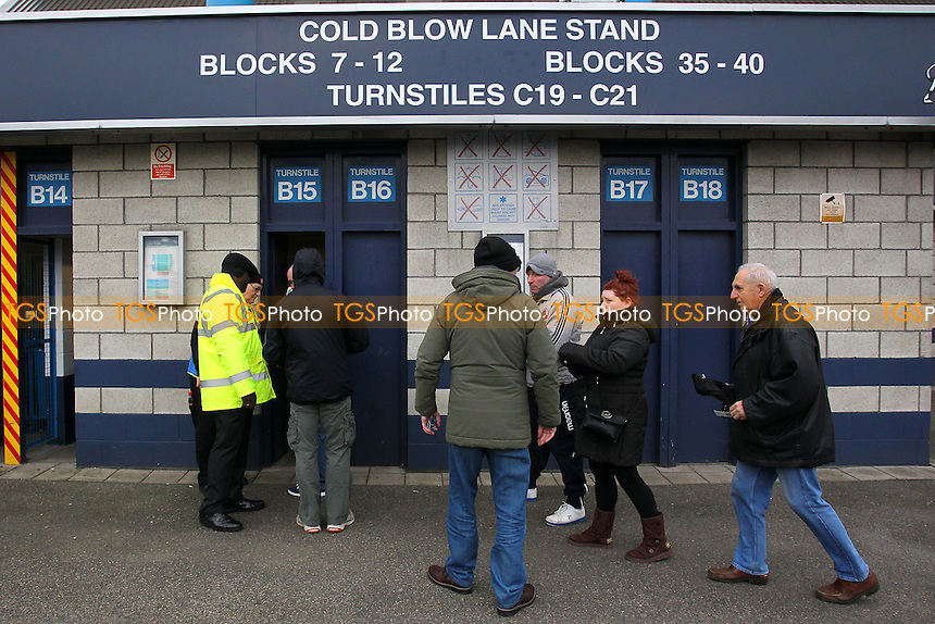 Spectators enter via the turnstiles ahead of kick-off during Millwall vs Wycombe Wanderers at The Den