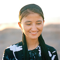 Portrait of local girl, Flaming Mountains, Silk Route, Turpan, Xinjiang Province, China.