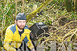 MOVE YOUR RUBBISH: Dave McBride from Castleisland was disgusted to find two dumped bags of rubbish and a television in Ballyseede Woods on Tuesday.