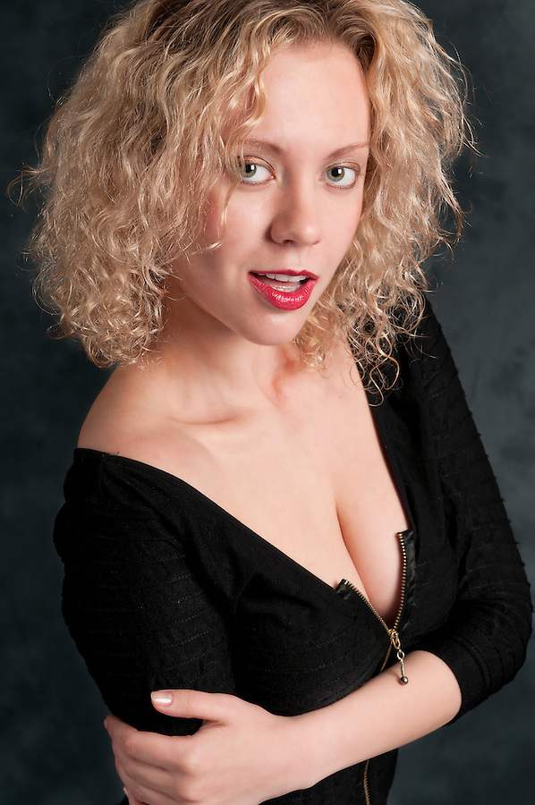 Young caucasian woman with curly hair looking very sensual