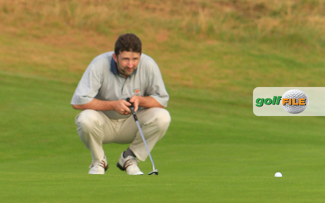 David Finn (Mallow) on the 1st green during the South of Ireland Amateur Open Championship Second Round at Lehinch Golf Club  28th July 2013 <br /> Picture:  Thos Caffrey / www.golffile.ie