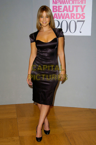 RACHEL STEVENS.At the New Women Beauty Awards, Cadogan Hall, Sloane Terrace, London, England, October 2nd 2007..full length black dress cap sleeves shoes.CAP/CAN.©Can Nguyen/Capital Pictures