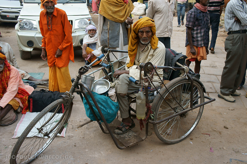 Handicapped man on the streets of Varanasi riding a special designed  bicycle