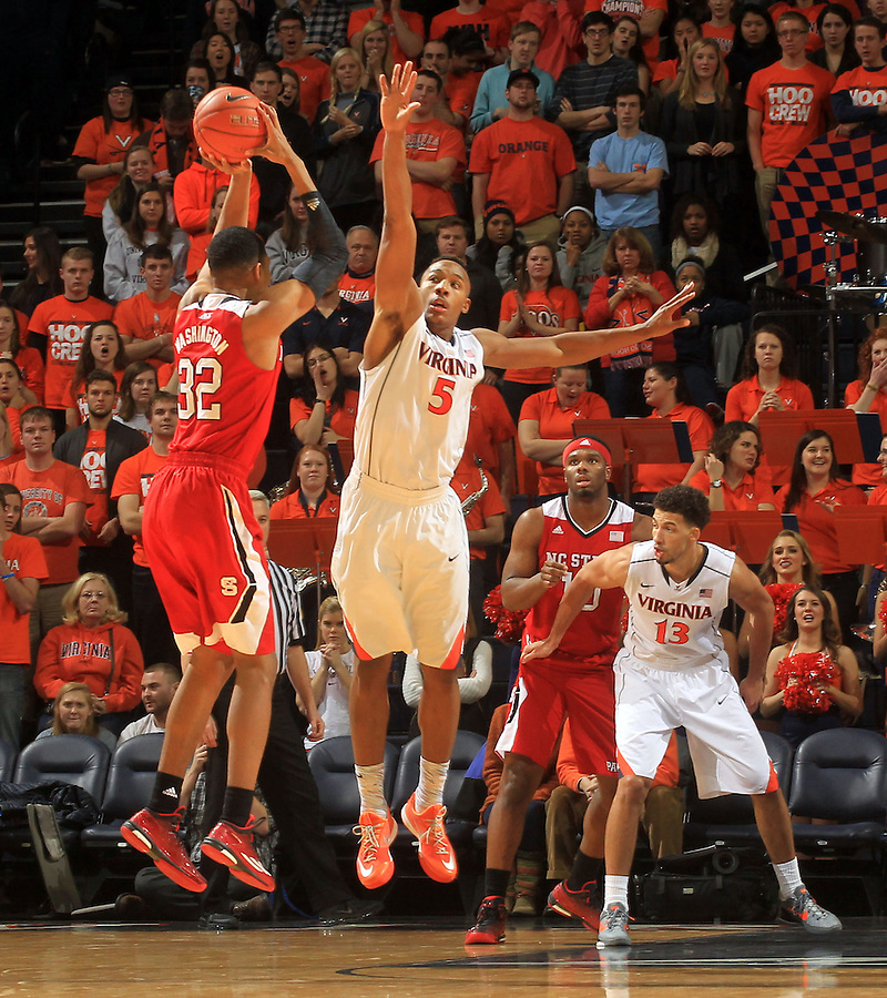 North Carolina State forward Kyle Washington (32) shoots over Virginia forward Darion Atkins (5) during the game Jan. 7, 2015, in Charlottesville, Va. Virginia defeated NC State  61-51.