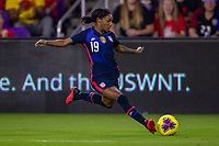 5th March 2020, Orlando, Florida, USA;  the United States defender Crystal Dunn (19) shoots on goal during the SheBelieves Cup match between England and the USA on March 5, 2020, at Exploria Stadium in Orlando FL.