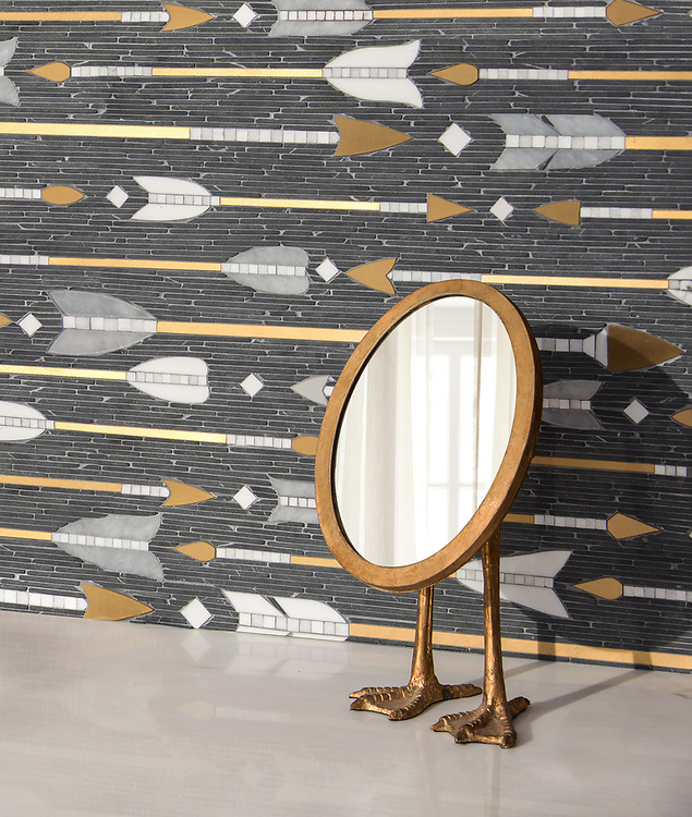 "Arrow Rows, a hand-cut stone mosaic, shown in tumbled Nero Marquina, polished Allure, Dolomite, Calacatta Radiance, and Brass, is part of Cean Irminger's second KIDDO Collection, ""KIDDO: Wunderkammer® Edition"" for New Ravenna."