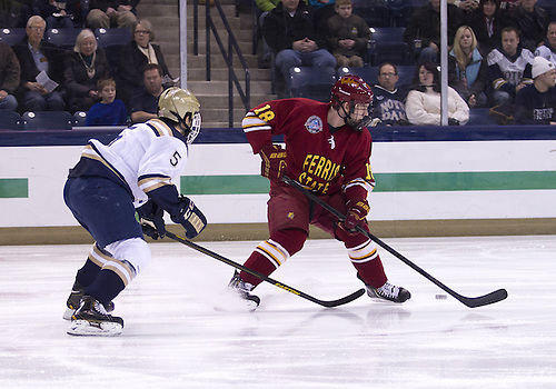 January 25, 2013:  Ferris State right wing Andy Huff (18) and Notre Dame defenseman Robbie Russo (5) battle for the loose puck during NCAA Hockey game action between the Notre Dame Fighting Irish and the Ferris State Bulldogs at Compton Family Ice Arena in South Bend, Indiana.  Ferris State defeated Notre Dame 3-1.