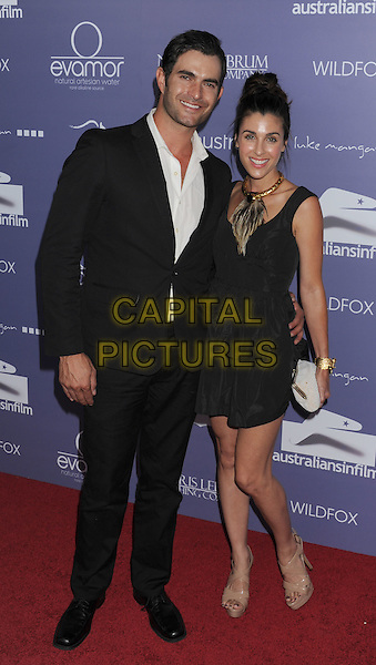 Owen Stanley, Monica Stanley.arriving at the 8th Annual Australians In Film Breakthrough Awards & Benefit Dinner at InterContinental Hotel in Century City, California, USA,.June 27th 2012. .full length black dress suit white shirt .CAP/ROT/TM.©TM/Roth Stock/Capital Pictures