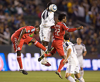 LA Galaxy forward Edson Buddle (14) heads a ball between Toronto FC players Nana Attakora (2-l) and Amadou Sanyang (22-r). The LA Galaxy and Toronto FC played to a 0-0 draw at Home Depot Center stadium in Carson, California on Saturday May 15, 2010.  .