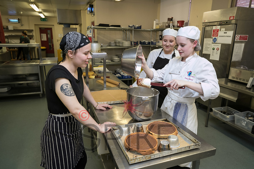 Ruddington Arms Commis Chef Casey Stanton (left) instructs Paisleigh Ryan and Esme Watson (right)