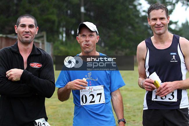 The top 3: Brent Stebbings(1st), Brian Kemp(3rd &amp; chewing banana) &amp; Peter Van Veen(2nd). Half Marathon &amp; Road Relay, Rabbit Island, SI Masters Games, 22 October 2011, Nelson, New Zealand<br /> Photo: Marc Palmano/shuttersport.co.nz
