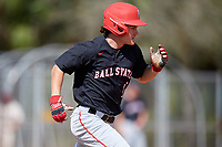 Ball State Cardinals left fielder Mack Murphy (12) runs to first base during a game against the Saint Joseph's Hawks on March 9, 2019 at North Charlotte Regional Park in Port Charlotte, Florida.  Ball State defeated Saint Joseph's 7-5.  (Mike Janes/Four Seam Images)