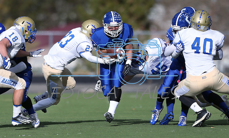 Carson's Elijah Fajayan runs against Reed during the NIAA D-1 Northern Regional title game at Bishop Manogue High School in Reno, Nev., on Saturday, Nov. 29, 2014. Reed won 28-25.<br /> Photo by Cathleen Allison