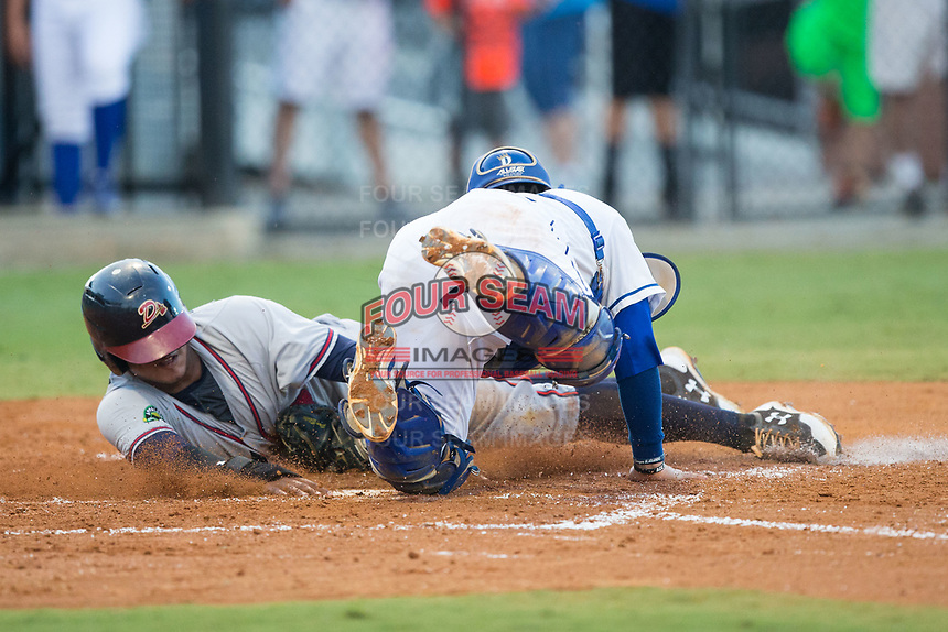 Kevin Maitan (26) of the Danville Braves is tagged out at home plate by Burlington Royals catcher Jesus Atencio (31) at Burlington Athletic Stadium on August 15, 2017 in Burlington, North Carolina.  The Royals defeated the Braves 6-2.  (Brian Westerholt/Four Seam Images)