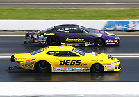 Jun 11, 2017; Englishtown , NJ, USA; NHRA pro stock driver Jeg Coughlin Jr (near) races alongside Vincent Nobile during the Summernationals at Old Bridge Township Raceway Park. Mandatory Credit: Mark J. Rebilas-USA TODAY Sports