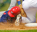 6 March 2006: Marlon Anderson, infielder for the Washington Nationals, slides into third base during a Spring Training game against the Los Angeles Dodgers. The Nationals and Dodgers played to a scoreless tie at Holeman Stadium, in Vero Beach Florida...Mandatory Photo Credit: Ed Wolfstein..