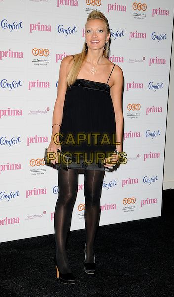 CAPRICE BOURRET.The Comfort Prima High Street Fashion Awards, Battersea Evolution Centre, Battersea Park, London, England. .September 11th, 2008.full length black dress polka dot tights clutch bag .CAP/CAN.©Can Nguyen/Capital Pictures.