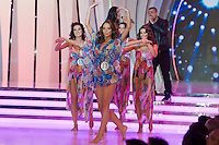 Singers Nora Trokan (L) and Caramel (R) perform during the Beauty Queen live TV show hosting the three beauty contests Miss World Hungary, Miss Universe Hungary and Miss Earth Hungary, held in Hungary's tv2 television headquarter in Budapest, Hungary on July 14, 2011. ATTILA VOLGYI