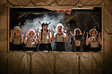 London, UK. 25.05.2016. THE THREEPENNY OPERA by Bertolt Brecht and Kurt Weill in a new adaptation by Simon Stephens, directed by Rufus Norris, opens in the Olivier Theatre on 26 May as part of the £15 Travelex season. Lighting design is by Paule Constable with set and costume design by Vicki Mortimer. Picture shows: The Company. Photograph © Jane Hobson.
