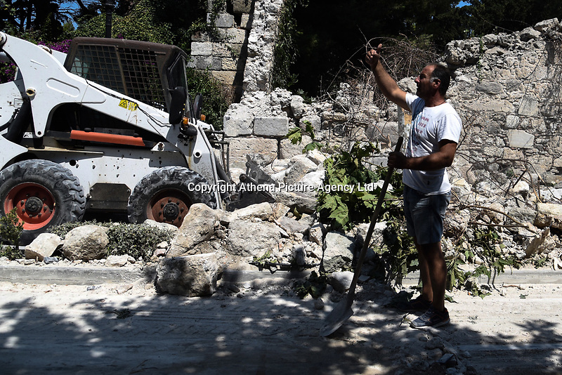 Pictured: A Council worker clears debris from the street in Kos town, Greece.<br /> Re: A 6.4 Richter Scale earthquake has hit the tourist island of Kos in Greece.