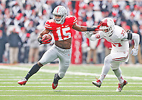 Ohio State Buckeyes running back Ezekiel Elliott (15) fends off Indiana Hoosiers safety Mark Murphy (37) in first quarter action at Ohio Stadium on 22, 2014. (Chris Russell/Dispatch Photo)