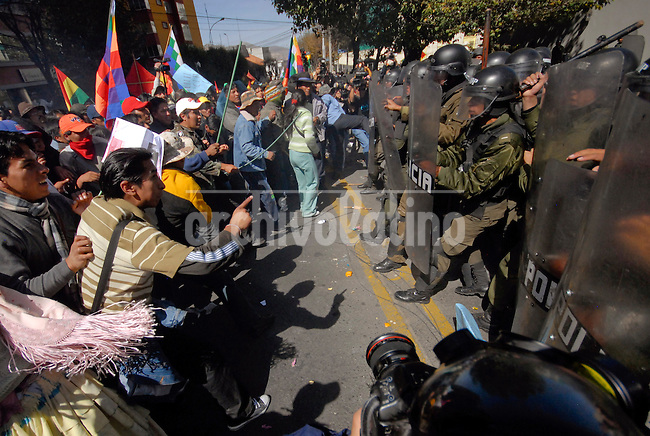 Demonstrators clash with police in front  the United States embassy in La Paz June 9, 2008. Thousands of supporters of leftist Bolivian President Evo Morales tried to storm the U.S. embassy in La Paz, demanding the United States repatriate two Bolivian rightwing politicians - former President Gonzalo Sanchez de Lozada and former government minister Carlos Sanchez Berzain.