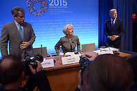 Washington, DC - April 16, 2015: Christine Lagarde, Managing Director of the International Monetary Fund, prepares for a press availability April 16, 2015 at the International Monetary Fund Headquarters in the District of Columbia during the annual Spring Meeting of the World Bank Group/IMF. Standing at left, David Lipton, First Deputy Managing Director, IMF. At right, Gerry Rice, IMF Director of Communications.  (Photo by Don Baxter/Media Images International)