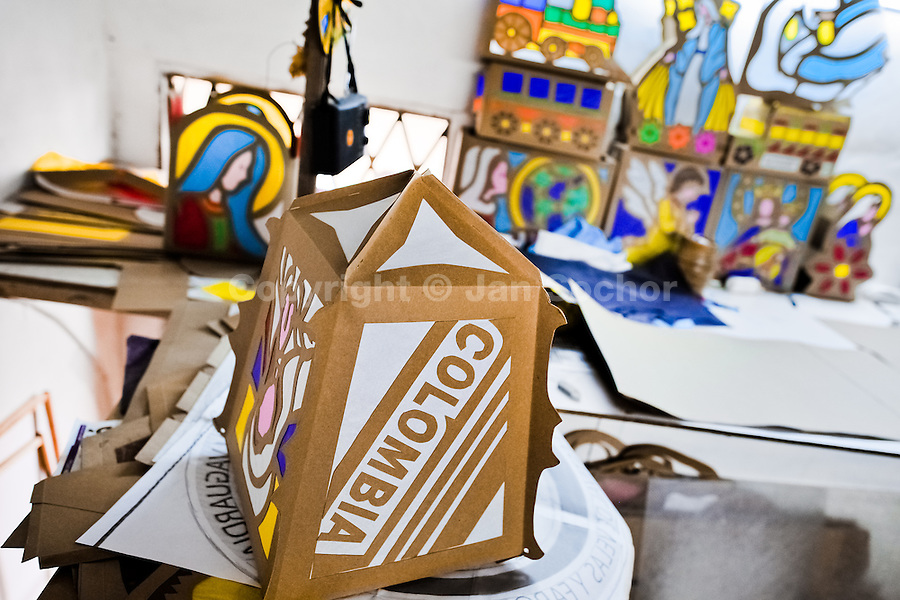 Colorful paper lanterns, depicting religious motives, are seen in an artist's workshop before the annual Festival of Candles and Lanterns in Quimbaya, Colombia, 8 December 2013. A vibrant event, celebrated since 1982 and attracting tens of thousands of visitors every year, is held in honor of the Virgin Mary, on the day of the Catholic Feast of the Immaculate Conception. Each street and neighborhood in the town compete in the contest to create the most spectacular lighting arrangement of their place, employing creatively elaborated lantern designs, which range from religious themes, to symbols of the coffee region or the environmental and wild nature motives. All the streets in Quimbaya center close for one night and some 40,000 lanterns are being lightened up at the festive night.